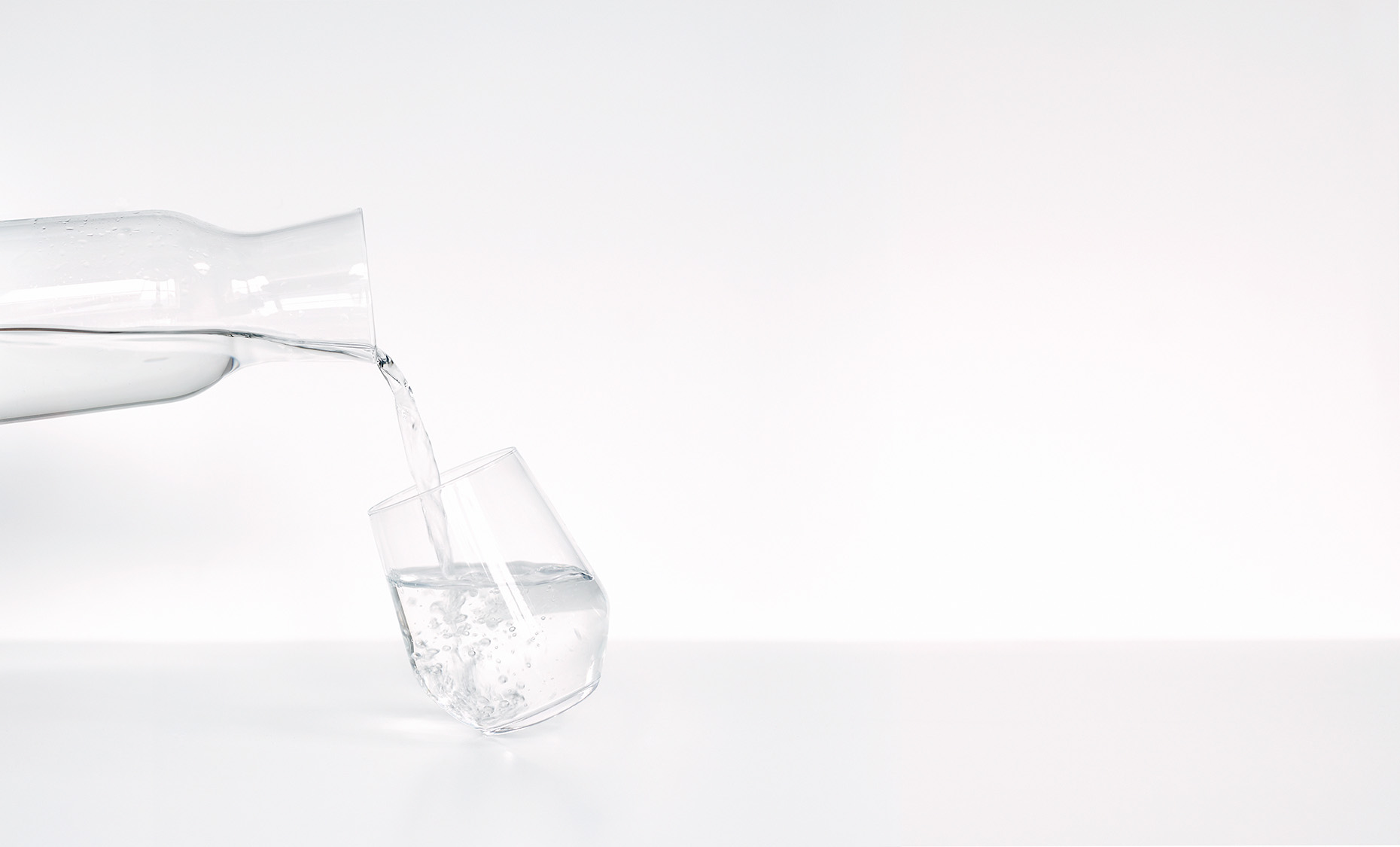 glass with water and carafe