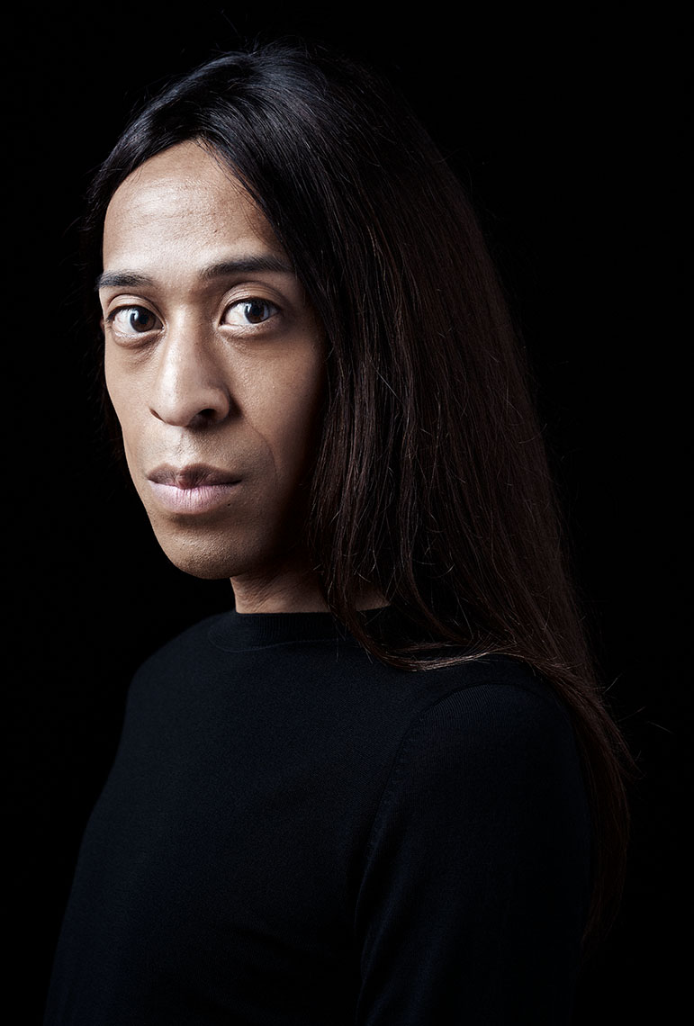 Portrait Frederique Androgynous man against black