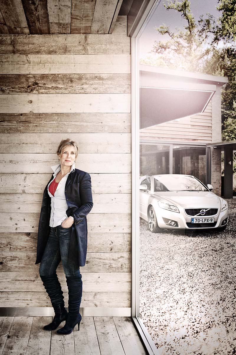 Woman with Volvo C70 in background